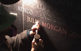 Julia MOrgan's name being chiseled into the AIA Gold Medal stone wall